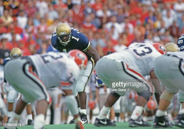 Ken Swilling, Defensive Back for the Georgia Tech Yellow Jackets keeps his eyes on the University of Georgia Bulldogs offensive line at the snap...