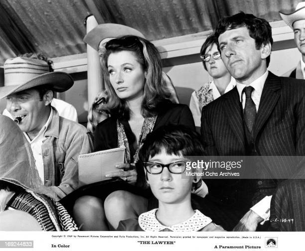 Ken Swofford Diana Muldaur and Barry Newman sit in a grandstand in a scene from the film 'The Lawyer' 1970