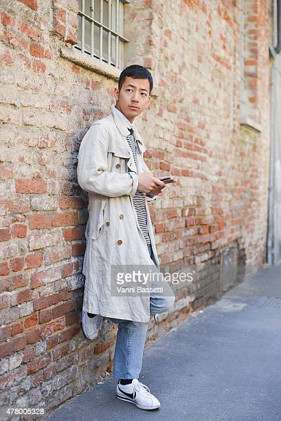 Ken Takehara poses wearing an Herald 55 trench on June 21 2015 in Milan Italy