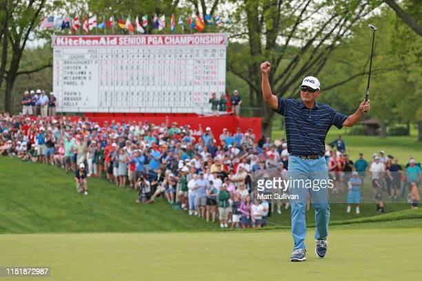 Ken Tanigawa celebrates after making a par on the 18th hole during the final round to win the KitchenAid Senior PGA Championship at Oak Hill Country...