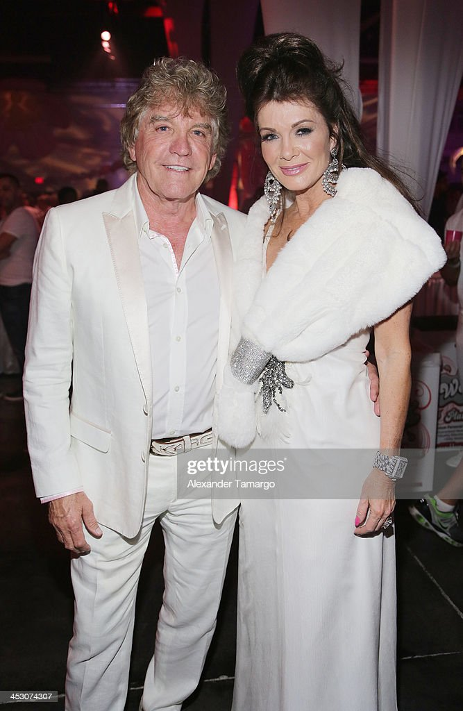 Ken Todd and Lisa Vanderpump pose during the debut of LVP sangria at The White Party in Miami and help raise awareness for HIV/AIDS at Soho Studios on November 30, 2013 in Miami, Florida.