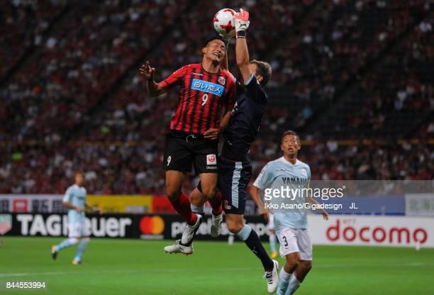Ken Tokura of Consadole Sapporo and Krzysztof Kaminski of Jubilo Iwata compete for the ball during the J.League J1 match between Consadole Sapporo...