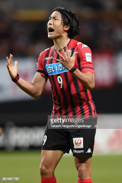 Ken Tokura of Consadole Sapporo celebrates scoring his side's first goal during the JLeague J1 match between Consadole Sapporo and Cerezo Osaka at...