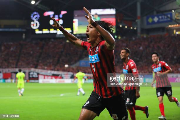 Ken Tokura of Consadole Sapporo celebrates scoring the opening goal during the JLeague J1 match between Consadole Sapporo and Urawa Red Diamonds at...