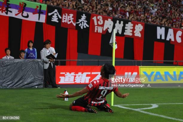 Ken Tokura of Consadole Sapporo celebrates scoring the opening goal during the JLeague J1 match between Consadole Sapporo and Urawa Red Diamonds at...
