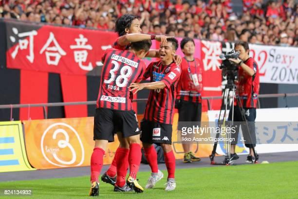 Ken Tokura of Consadole Sapporo celebrates scoring the opening goal with his team mates Daiki Suga and Chanathip Songkrasin during the JLeague J1...