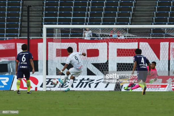 Ken Tokura of Consadole Sapporo converts the penalty to score his side's first goal during the J.League J1 match between Sanfrecce Hiroshima and...