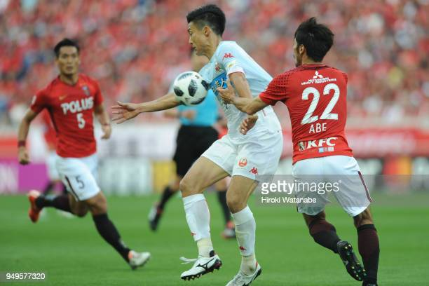Ken Tokura of Consadole Sapporo in action during the JLeague J1 match between Urawa Red Diamonds and Consadole Sapporo at Saitama Stadium on April 21...
