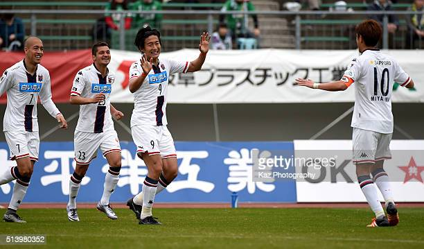Ken Tokura of Cosadole Sapporo celebrats the opener with Hiroki Miyazawa of Cosadole Sapporo during the JLeague second division match between FC Gifu...