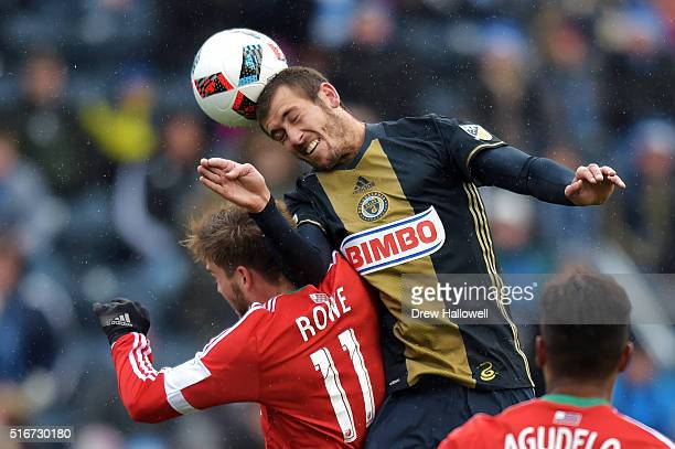 Ken Tribbett of Philadelphia Union heads the ball on goal over Kelyn Rowe of New England Revolution at Talen Energy Stadium on March 20 2016 in...
