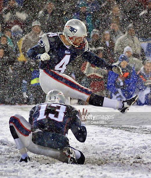 Ken Walter holds as field kicker Adam Vinatieri of the New England Patriots makes the gamewinning 1613 field goal in overtime against the Oakland...