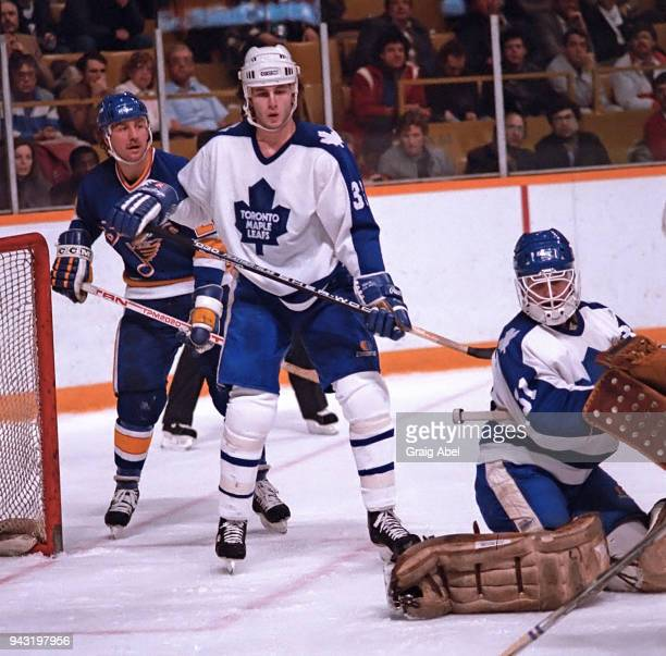 Ken Wregget and Al Iafrate of the Toronto Maple skate against Bernie Federko of the St Louis Blues during game action on December 11 1985 at Maple...