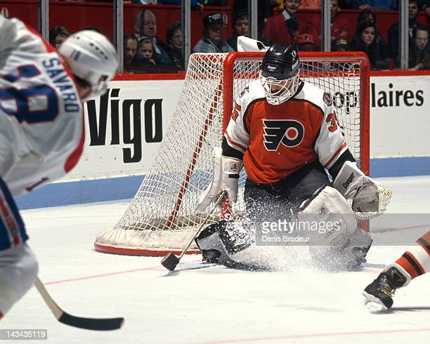 Ken Wregget of the Philadelphia Flyers makes a save on a shot by Denis Savard of the Montreal Canadiens Circa 1990 at the Montreal Forum in Montreal...