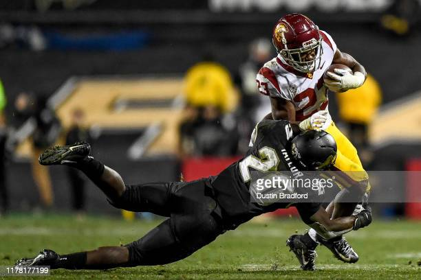 Kenan Christon of the USC Trojans is tackled by Davion Taylor of the Colorado Buffaloes in the fourth quarter of a game at Folsom Field on October...