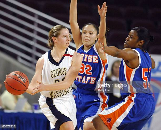 Kenan Cole of George Washington is defended by Nadia Begay and Jackie Thompson of Boise State in the NCAA Women's Basketball Tournament firstround...