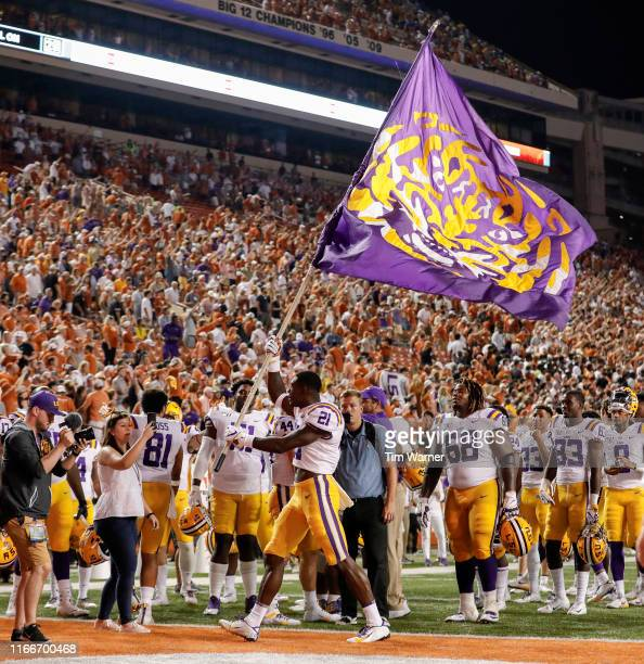 Kenan Jones of the LSU Tigers celebrates with a flag after the game against the Texas Longhorns at Darrell K RoyalTexas Memorial Stadium on September...
