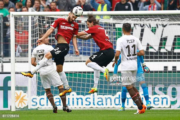 Kenan Karaman and Stefan Strandberg of Hannover challenges Bernd Nehrig and Aziz Bouhaddouz of St Pauli during the Second Bundesliga match between...