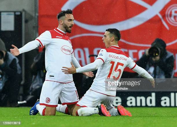 Kenan Karaman of Duesseldorf celebrates after scoring his team's first goal during the Bundesliga match between Fortuna Duesseldorf and Hertha BSC at...