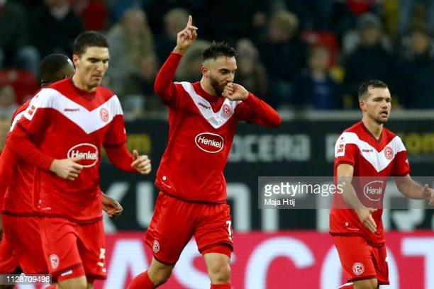 Kenan Karaman of Duesseldorf celebrates scoring the opening goal during the Bundesliga match between Fortuna Duesseldorf and VfB Stuttgart at...
