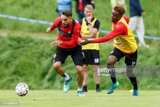 Kenan Karaman of Fortuna Duesseldorf and Anderson Lucoqui of Fortuna Duesseldorf battle for the ball during the Fortuna Duesseldorf training camp on...