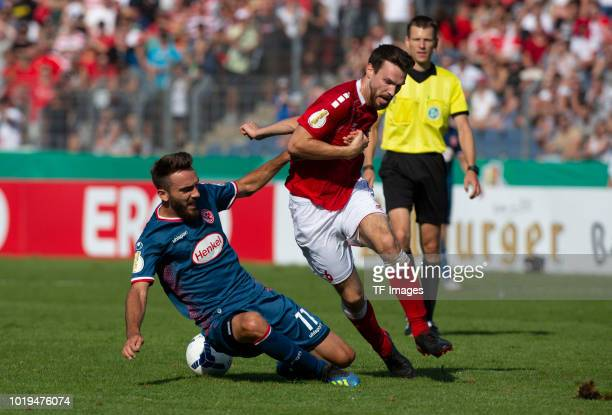Kenan Karaman of Fortuna Duesseldorf and Marvin Sauerborn of RW Koblenz battle for the ball during the DFB Cup first round match between TuS RW...