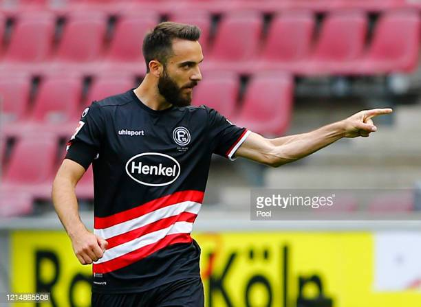 Kenan Karaman of Fortuna Duesseldorf celebrates after he scores his sides first goal during the Bundesliga match between 1. FC Koeln and Fortuna...