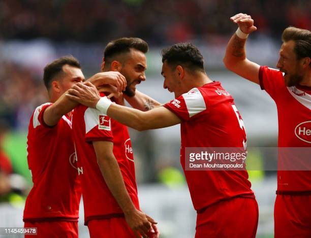 Kenan Karaman of Fortuna Duesseldorf celebrates after scoring his team's second goal with team mates during the Bundesliga match between Fortuna...