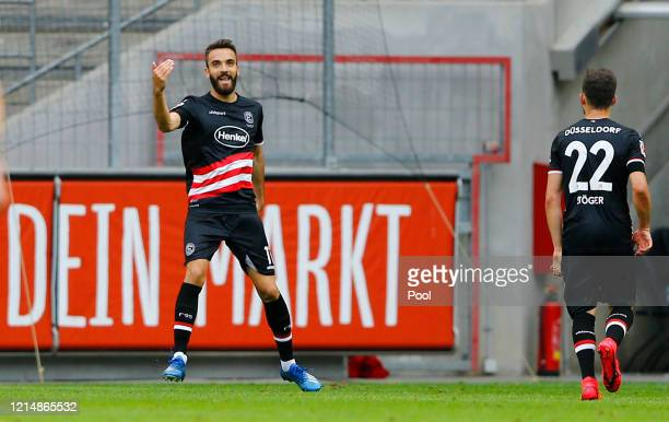 Kenan Karaman of Fortuna Duesseldorf celebrates after scoring his teams first goal during the Bundesliga match between 1. FC Koeln and Fortuna...