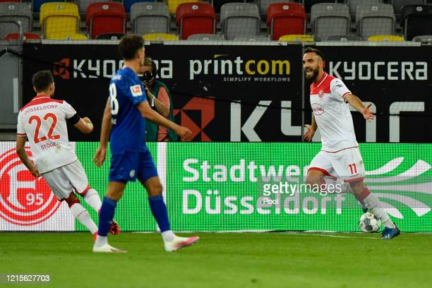 Kenan Karaman of Fortuna Duesseldorf celebrates after scoring his team's second goal during the Bundesliga match between Fortuna Duesseldorf and FC...