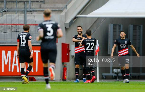 Kenan Karaman of Fortuna Duesseldorf celebrates with his team after he score his teams first goal during the Bundesliga match between 1. FC Koeln and...