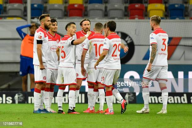 Kenan Karaman of Fortuna Duesseldorf celebrates with his team mates after scoring his team's second goal during the Bundesliga match between Fortuna...