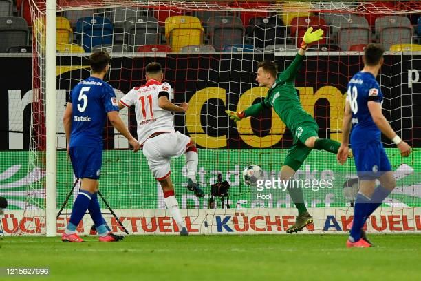 Kenan Karaman of Fortuna Duesseldorf scores his team's second goal past Markus Schubert of FC Schalke 04 during the Bundesliga match between Fortuna...
