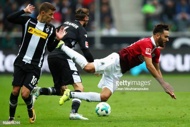 Kenan Karaman of Hannover 96 battles for the ball with Thorgan Hazard and Christoph Kramer Borussia Monchengladbach during the Bundesliga match...