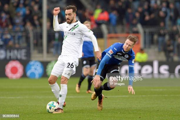 Kenan Karaman of Hannover and Brian Behrendt of Bielefeld battle for the ball during the HHotelscom Wintercup match between Arminia Bielefeld and...