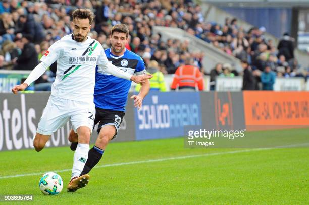 Kenan Karaman of Hannover and Florian Dick of Bielefeld battle for the ball during the HHotelscom Wintercup match between Arminia Bielefeld and...