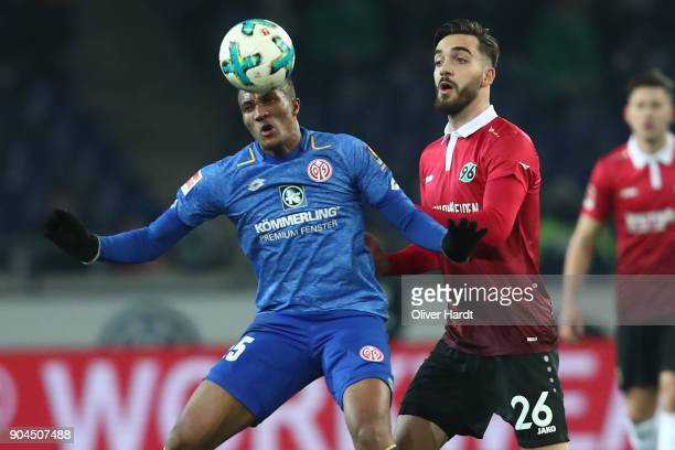 Kenan Karaman of Hannover and Jean Philippe Gbamin of Mainz compete for the ball during the Bundesliga match between Hannover 96 and 1 FSV Mainz 05...