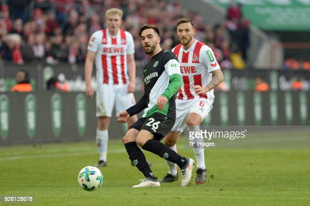 Kenan Karaman of Hannover and Marco Hoeger of Koeln battle for the ball during the Bundesliga match between 1 FC Koeln and Hannover 96 at...
