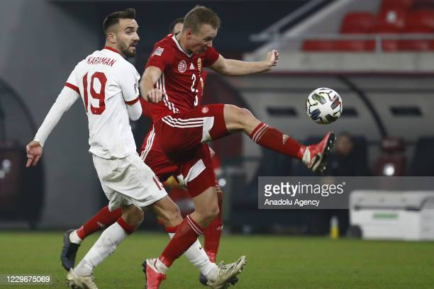 Kenan Karaman of Turkey in action against Adam Lang of Hungary during the UEFA Nations League match between Hungary and Turkey at Puskas Arena in...