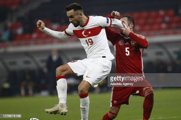 Kenan Karaman of Turkey in action against Attila Fiola of Hungary during the UEFA Nations League match between Hungary and Turkey at Puskas Arena in...