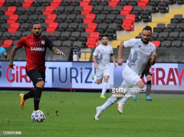 Kenan Ozer of Gaziantep FK in action against Musa Cagiran of Ittifak Holding Konyaspor during Turkish Super Lig match between Gaziantep FK and...