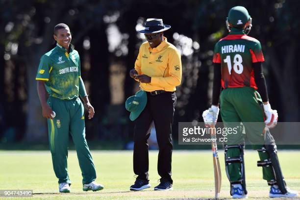 Kenan Smith of South Africa and umpire Langton Rusere reacting during the ICC U19 Cricket World Cup match between South Africa and Kenya at Lincoln...