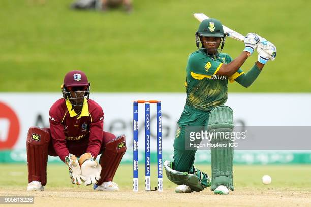 Kenan Smith of South Africa bats while captain Emmanuel Stewart of the West Indies looks on during the ICC U19 Cricket World Cup match between the...