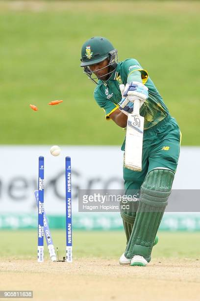 Kenan Smith of South Africa is bowled out during the ICC U19 Cricket World Cup match between the West Indies and South Africa at Bay Oval on January...