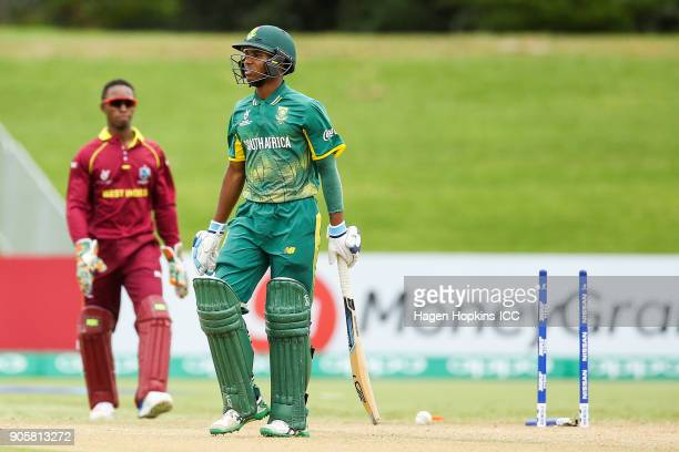 Kenan Smith of South Africa leaves the field after being dismissed during the ICC U19 Cricket World Cup match between the West Indies and South...