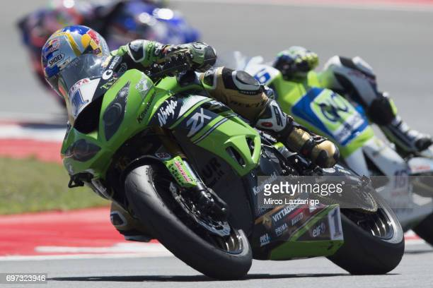 Kenan Sofuoglu of Turkey and Kawasaki Puccetti Racing leads Jules Cluzel of France and CIA Landlord Insurance Honda during the SuperSport Race during...