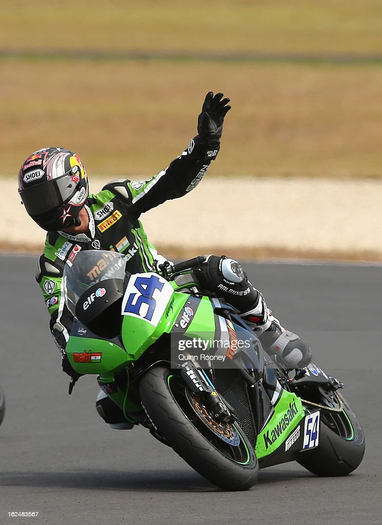 Kenan Sofuoglu of Turkey riding the #54 Kawasaki ZX-6R celebrates winning the World Supersport Race at Phillip Island Grand Prix Circuit on February 24, 2013 in Phillip Island, Australia.