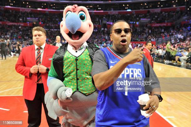 Kenan Thompson and Clippers mascot Chuck the Condor get the crowd excited during a basketball game between the Los Angeles Clippers and the Brooklyn...