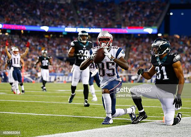 Kenbrell Thompkins of the New England Patriots celebrates his touchdown in the first quarter in front of Curtis March of the Philadelphia Eagles...