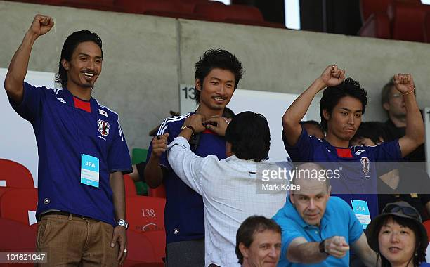 Kenchi, Makidai and Tetsuya of the all-male Japanese pop band and dance group Exile watch on during the Japan v Ivory Coast International Friendly...