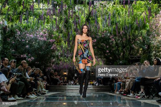 Kendal Jenner walks the runway at the Versace show during Milan Men's Fashion Week Spring/Summer 2019 on June 16 2018 in Milan Italy